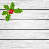Holly berry on wooden background Stock Photo