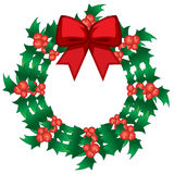 holly berry wreath with bow Royalty Free Stock Image