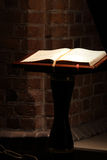 Holly bible in old church Stock Photo