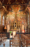 Holly Blod Basilique Bruges Belgium. The wood painted wall and altar inside the Holly Blod Basilique, Belgium, Bruges stock photos