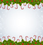 Holly and candy canes Christmas decoration Stock Image
