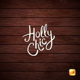 Holly Chic Phrase op Abstracte Houten Achtergrond stock foto