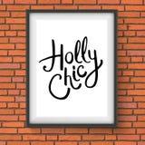 Holly Chic Text en una ejecución del marco en una pared Foto de archivo libre de regalías