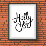 Holly Chic Text in a Frame Hanging on a Wall Royalty Free Stock Photo