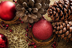 Holly Christmas Decoration. Cones and baubles Stock Photography