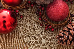 Holly Christmas Decoration. Cones and baubles Stock Images