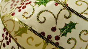 Holly Christmas ribbon Stock Images