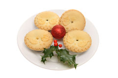 Holly decorated mince pies Royalty Free Stock Image