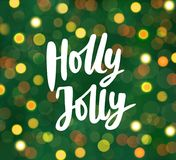 Holly Jolly text, hand drawn lettering. Blurred background with glowing lights. Great for Christmas, New year cards. Holly Jolly text, hand drawn lettering royalty free illustration