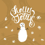 Holly Jolly- unique handwritten lettering with snowman. Holiday greeting card, background. Royalty Free Stock Image