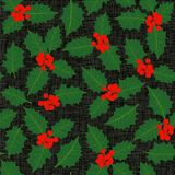 Holly leaves and berries seamless pattern on dark Royalty Free Stock Photo