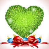 Holly Leaves Heart con las bolas de la Navidad Fotos de archivo