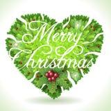 Holly Leaves Heart y texto caligráfico de la Feliz Navidad Imagen de archivo