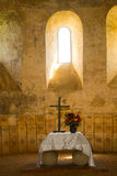 Holly light upon altar in an ancient church. Holly light upon altaR in the fortress church of Cisnadioara & x28;Michelsberg& x29;, Transylvania, Romania Stock Image