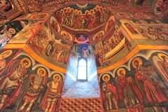 Holly light revealing interior icons of the church Stock Photography