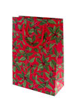 Holly pattern party present bag stock image