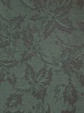 Holly patterned fabric. Green fabric with a woven holly pattern Stock Image