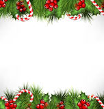 Holly with pine and candys isolated on white. Holly sprigs with pine branches and candy canes isolated on white background Stock Images