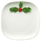 Holly on plate Royalty Free Stock Photo