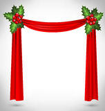 Holly sprigs hold red curtain on grayscale Stock Photography