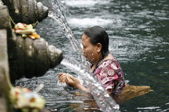 Holly springs in Balinese Tirta Empul Temple Stock Photography
