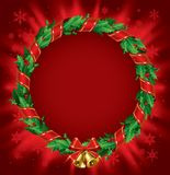 Holly wreath. Isolated raster version of  green holly wreath with a red ribbon and gold bells on the red shining background Stock Image