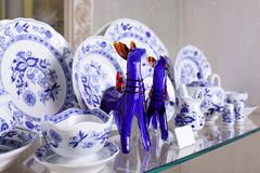 Hollyday dishes. Shelf with different brand new holiday dishes Stock Photos