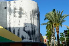 Hollywood arts walk building. One of the buildings along the Hollywood art walk in downtown Hollywood on a clear day with the palm trees and clear blue sky Royalty Free Stock Photo