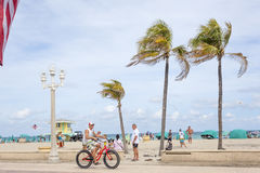 Hollywood Beach Broad Walk, Florida. Hollywood Beach, Fl, USA - March 13, 2017: Bicycle rider at the Hollywood Beach Broad Walk. Florida, United States Royalty Free Stock Image
