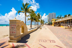 Hollywood Beach Florida. Hollywood Beach, Florida - July 6, 2017: The promenade along the beach lined with palm trees and resorts is a popular tourist Royalty Free Stock Photos