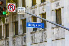 Hollywood Blvd street sign with tall palm trees. Royalty Free Stock Photos