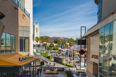 Hollywood Hills, view from Dolby Theatre and Highland Center. Hollywood Boulevard, Hollywood Hills, traffic and pedestrians on Hollywood Boulevard, Colorful royalty free stock photography