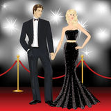 Hollywood couple. Beautiful famous hollywood couple, fashion woman and elegant man on red carpet Royalty Free Stock Images
