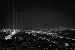 Hollywood and Downtown Los Angeles at night with spot lights. Hollywood, west hollywood, and downtown los angeles at night in black and white. Spot lights are royalty free stock photo