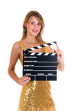 Hollywood Female actress. Young attractive female actress in gold dress with movie clip board .  studio shot, white background Stock Image