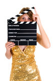 Hollywood Female actress. Young attractive female actress in gold dress with movie clip board .  studio shot, white background Stock Images