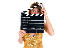 Hollywood Female actress. Young attractive female actress in gold dress with movie clip board .  studio shot, white background Stock Photo