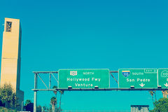 Hollywood freeway sign by Cathedral of Our Lady of Angels steepl Stock Images