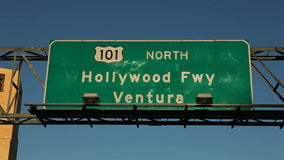 Hollywood 101 Freeway Sign. Editorial driving view of Hollywood 101 Freeway signs with graffiti stock video