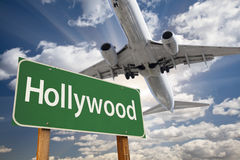 Hollywood Green Road Sign and Airplane Above Royalty Free Stock Images