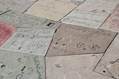 Hollywood hand prints. LOS ANGELES, USA - APRIL 5, 2014: Celebrity foot and hand prints in front of TCL Chinese Theatre in Hollywood. The theatre has a stock photo