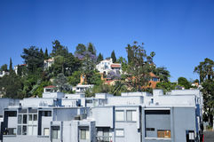 Hollywood Hills Los Angeles. Expensive homes and modern apartments in the Los Angeles Hills overlooking the hollywood area of the city surrounded by trees and Stock Images
