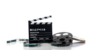 Hollywood Movie Items. On a white background, including a movie clapboard, film reel, film containers or tins and film Royalty Free Stock Photography