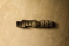 HOLLYWOOD - Nahaufnahme des grungy Weinlese gesetzten Wortes auf Metallhintergrund Stockbild