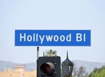 Hollywood-Querstation-Straßenschild Lizenzfreie Stockbilder