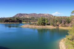 Hollywood Reservoir. Landscape with small Hollywood sign visible in background Royalty Free Stock Images