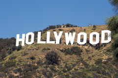 Hollywood Sign. Image of the Hollywood Sign with yellow flowers in the foreground Royalty Free Stock Photography