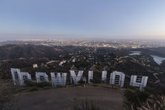 Hollywood Sign Dusk. LOS ANGELES, CALIFORNIA - July 2, 2014:  Back of the Hollywood sign above the city of Los Angeles at dusk Royalty Free Stock Photos