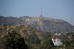 Hollywood Sign. The Hollywood Sign, viewed from Hollywood Boulevard, is a landmark and American cultural icon located on Mount Lee in the Hollywood Hills area of Royalty Free Stock Photo