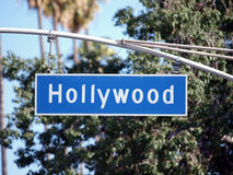 Hollywood Signage. Hollywood Blvd street sign with tall trees Stock Photo